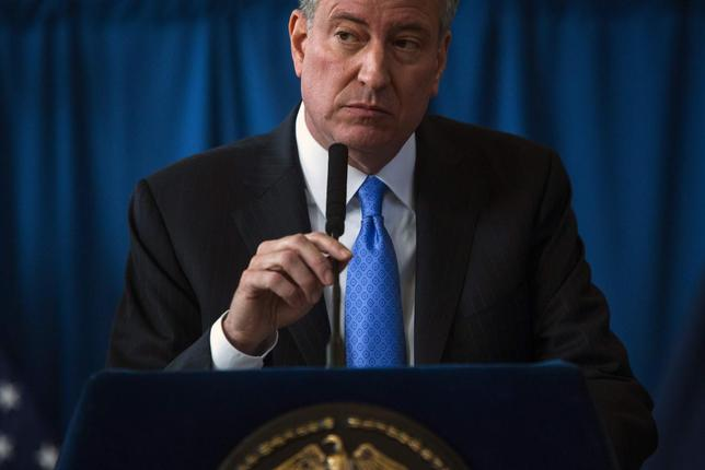 New York Mayor Bill de Blasio speaks at a news conference in the Brownsville neighborhood in the borough of Brooklyn, New York January 30, 2014. REUTERS/Eric Thayer