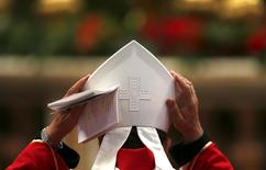 An archbishop adjusts his mitre ahead of the conferral of the sacred pallium by Pope Francis at St. Peter's Basilica in the Vatican June 29, 2013. REUTERS/Alessandro Bianchi