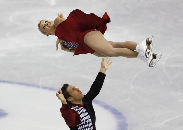 Kirsten Moore-Towers and Dylan Moscovitch of Canada perform during the pairs short programme at the ISU Grand Prix of Figure Skating Final in Fukuoka, southwestern Japan December 6, 2013. REUTERS/Issei Kato