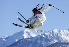 Swedish skier Henrik Harlaut goes off a jump during slopestyle skiing training at the 2014 Sochi Winter Olympics in Rosa Khutor February 5, 2014. REUTERS/Mike Blake