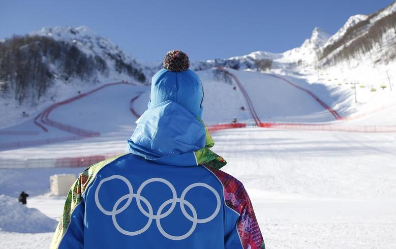 A volunteer looks up to the start of the downhill courses at the Rosa Khutor Alpine Skiing mountain resort ahead of the Sochi 2014 Winter Olympic Games February 5, 2014. REUTERS/Leonhard Foeger