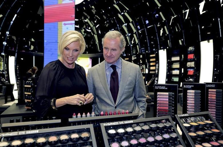 Fabrizio Freda (R), President and CEO, The Estee Lauder Companies, and Karen Buglisi (L), Global Brand President, M.A.C Cosmetics, pose in the M.A.C shop in Paris, February 28, 2013. REUTERS/Philippe Wojazer