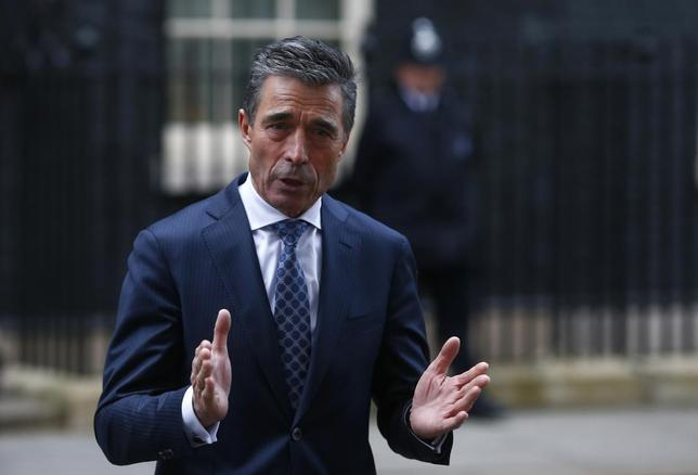 Secretary General of NATO Anders Fogh Rasmussen speaks to media after meeting Britain's Prime Minister David Cameron at 10 Downing Street, in central London February 3, 2014. REUTERS/Andrew Winning