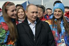 Russian President Vladimir Putin (C) and Olympic Village Mayor Elena Isinbaeva (R) visit the Coastal Cluster Olympic Village ahead of the Sochi 2014 Winter Olympics at the Athletes Village in Sochi February 5, 2014. REUTERS/Pascal Le Segretain/Pool