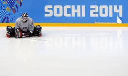 Team USA goaltender Brianne McLaughlin stretches before their women's ice hockey team practice at the Shayba Arena ahead of the 2014 Sochi Winter Olympics February 3, 2014. REUTERS/Mark Blinch