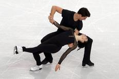 Tessa Virtue and Scott Moir of Canada skate during an ice dance figure skating training session at the Iceberg Skating Palace in preparation for the 2014 Sochi Winter Olympics February 5, 2014. REUTERS/David Gray