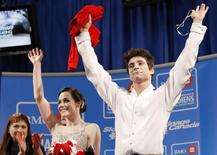 Canada's Tessa Virtue (C) and Scott Moir (R) celebrate with their coach Marina Zoueva following their Senior Dance Free Dance routine at the 2010 Canadian Figure Skating Championships in London, Ontario, January 16, 2010. REUTERS/Mark Blinch