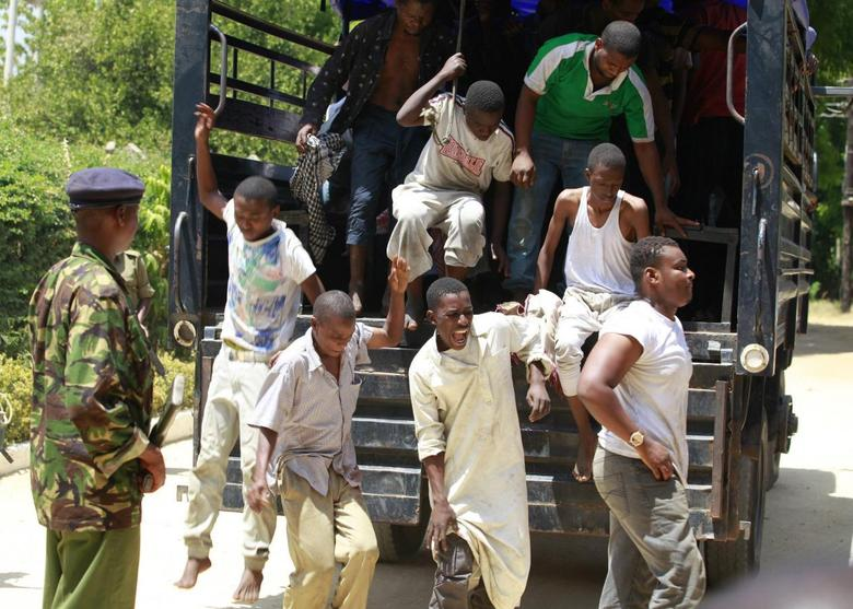 Muslim youths, who were detained by police from Sunday's raid at the Masjid Musa mosque, disembark from a vehicle as they arrive at a court in Shanzu, a small town along the north coast of Mombasa, February 3, 2014. REUTERS/Joseph Okanga