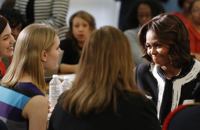 First lady Michelle Obama prepares to talk to parents and students after she delivers remarks at a Free Application for Federal Student Aid Workshop at T.C. Williams High School-King Street Campus in Alexandria, Virginia, February 5, 2014. REUTERS/Larry Downing