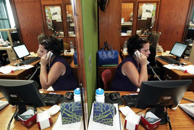 Cuban doctor, Ramona Rodriguez, 51, speaks on the phone in the office of the center-right Democratas Party where she presented her request for political asylum in Brasilia, February 5, 2014. REUTERS/Joedson Alves