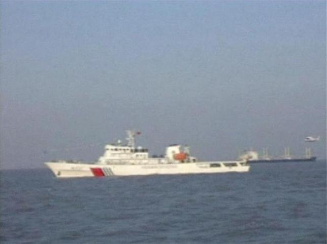 A helicopter approaches to land on patrol vessel ''Haixun 21'' in this still image taken from a December 27, 2012 video footage. REUTERS/China Central Television via Reuters TV