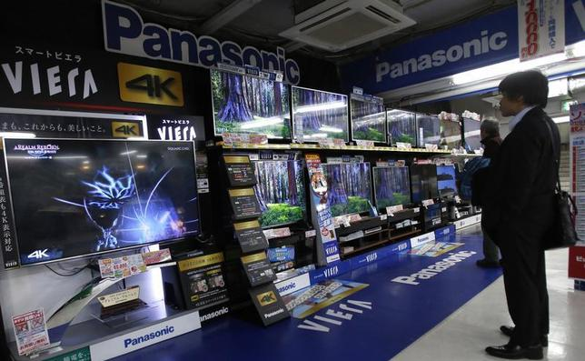 A shopper looks at Panasonic Corp's Viera televisions displayed at an electronics retail store in Tokyo February 3, 2014. REUTERS/Yuya Shino