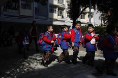 Students, who live in Shenzhen, leave their school at a public housing estate in Hong Kong December 19, 2013, before crossing the border back to mainland China. REUTERS/Bobby Yip