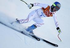 Laurenne Ross of the U.S. speeds down the course during the first training session for the women's alpine skiing downhill event at the 2014 Sochi Winter Olympics at the Rosa Khutor Alpine Center February 6, 2014. REUTERS/Mike Segar