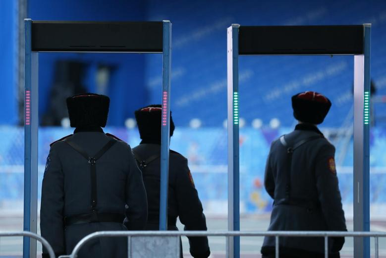 Russian Cossacks enter a security checkpoint as preparations continue for the 2014 Sochi Winter Olympics in Rosa Khutor February 6, 2014. REUTERS/Stefan Wermuth