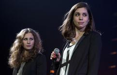 "Russian punk band Pussy Riot members Maria Alyokhina (L) and Nadezhda Tolokonnikova speak on stage during Amnesty International's ""Bringing Human Rights Home"" concert in the Brooklyn borough of New York February 5, 2014. The two members took to a New York stage on Wednesday evening to demand the release of anti-government prisoners as Russia prepares to open the Winter Olympics in Sochi. REUTERS/Carlo Allegri"