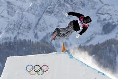 Finland's Janne Korpi performs a jump during the men's slopestyle snowboarding qualifying session at the 2014 Sochi Olympic Games in Rosa Khutor February 6, 2014. REUTERS/Dylan Martinez