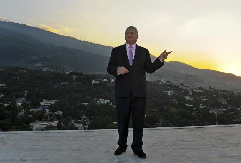 Digicel Chairman Denis O'Brien poses on the rooftop of his company's headquarters in Port-au-Prince December 18, 2012. REUTERS/Swoan Parker