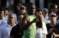 Jamaican sprinter Usain Bolt gestures before competing in a race against a public bus during a demonstration event in Buenos Aires December 14, 2013 file photo. REUTERS/Marcos Brindicci