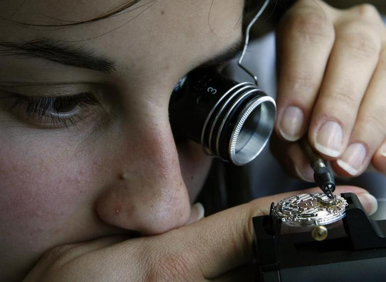 A Vacheron Constantin watchmaker adjusts a movement in the company headquarters in Plan-les-Ouates near Geneva May 23, 2007. REUTERS/Denis Balibouse