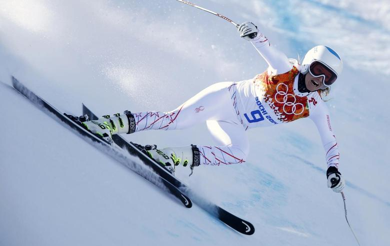 Julia Mancuso of the U.S. speeds down the course in the first training session for the women's alpine skiing downhill event during the 2014 Sochi Winter Olympics at the Rosa Khutor Alpine Center February 6, 2014. REUTERS/Mike Segar