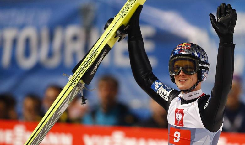 Austria's Thomas Morgenstern reacts after taking the second place in the overall ranking of the four-hills ski jumping tournament after the final jumping in Bischofshofen, January 6, 2014. REUTERS/Kai Pfaffenbach