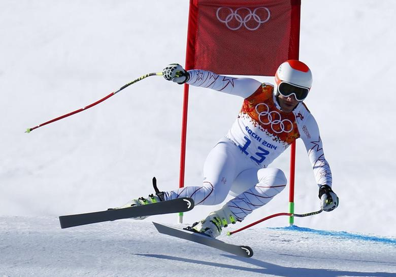 Bode Miller of the U.S. speeds down the course in the first training session for the men's alpine skiing downhill event during the 2014 Sochi Winter Olympics at the Rosa Khutor Alpine Center February 6, 2014. REUTERS/Dominic Ebenbichler