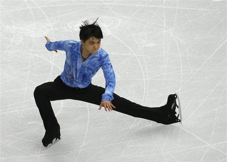 Japan's Yuzuru Hanyu performs during the figure skating team men's short program at the Sochi 2014 Winter Olympics February 6, 2014. REUTERS/David Gray