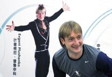Former Olympic champion figure skater Yevgeny Plushenko of Russia smiles as he leaves a news conference in Beijing September 3, 2010 file photo. REUTERS/David Gray