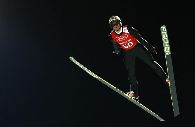Austria's Thomas Morgenstern soars through the air during the men's ski jumping individual normal hill training event of the Sochi 2014 Winter Olympic Games, at the RusSki Gorki Ski Jumping Center in Rosa Khutor, February 6, 2014. REUTERS/Michael Dalder