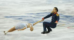 Tatiana Volosozhar and Maxim Trankov of Russia compete during the Team Pairs Short Program at the Sochi 2014 Winter Olympics, February 6, 2014. REUTERS/Brian Snyder