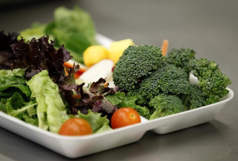 Some of more than 8,000lbs of locally grown broccoli from a partnership between Farm to School and Healthy School Meals is served in a salad to students at Marston Middle School in San Diego, California, March 7, 2011. REUTERS/Mike Blake