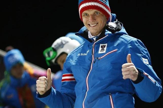 Austria's Thomas Morgenstern gives thumbs up ahead of his jump during the men's ski jumping individual normal hill training event of the Sochi 2014 Winter Olympic Games, at the RusSki Gorki Ski Jumping Center in Rosa Khutor, February 6, 2014. REUTERS/Kai Pfaffenbach