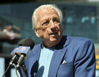 Hall of Fame player and broadcaster Ralph Kiner, beginning his 51st year with the New York Mets, announces the starting lineup before their MLB National League opening day baseball game with the Atlanta Braves at CitiField in New York, in this file April 5, 2012 photo. REUTERS/Ray Stubblebine
