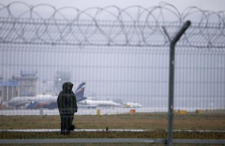 Russian police officer stands guard in front Sochi's airport in Adler, January 23, 2014. REUTERS/Alexander Demianchuk