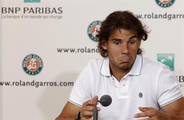 Rafael Nadal speaks during a news conference in Paris June 9, 2012. REUTERS/Benoit Tessier/Files