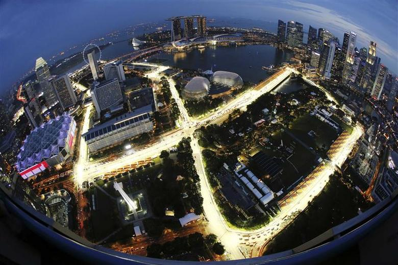 The Marina Bay Formula One street circuit is illuminated at dusk in Singapore, in this September 17, 2013 file photo. REUTERS/Edgar Su/Files