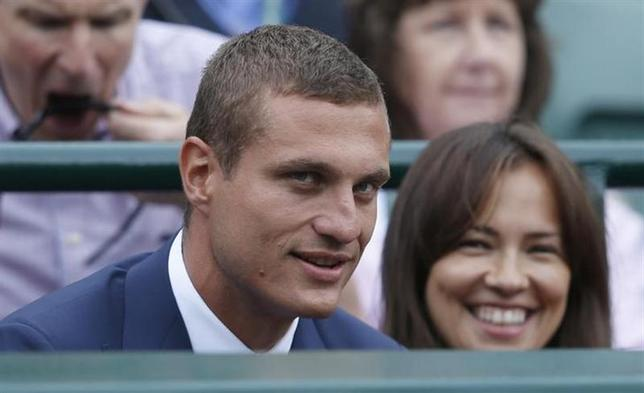 Manchester United defender Nemanja Vidic and his wife Ana sit on court one at the Wimbledon Tennis Championships, in London July 3, 2013. REUTERS/Eddie Keogh/Files