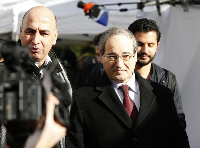 Syria's Deputy Foreign Minister Faisal Mekdad (C), who is a part of a Syrian government delegation, arrives for a meeting with U.N.-Arab League envoy for Syria Lakhdar Brahimi (not seen) at a U.N. office in Geneva January 24, 2014. REUTERS/Jamal Saidi