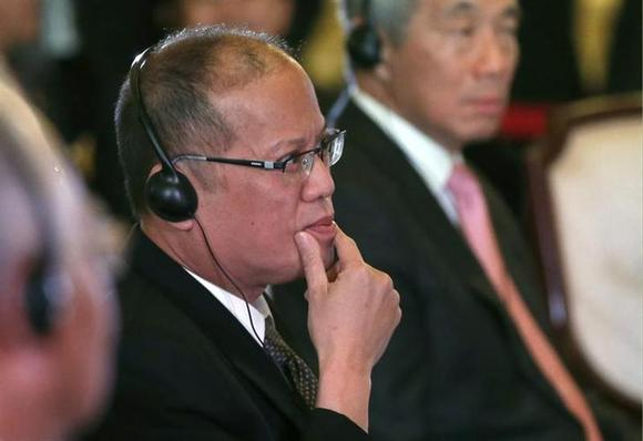 Philippine President Benigno Aquino attends the first session of the ASEAN-Japan Commemorative Summit Meeting at the state guest house in Tokyo December 14, 2013. REUTERS/Toru Hanai/Files