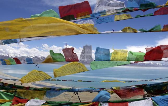 Buddhist prayer flags flutter in the wind near Namthso Lake in Tibet June 7, 2009. REUTERS/Ang Tshring Sherpa