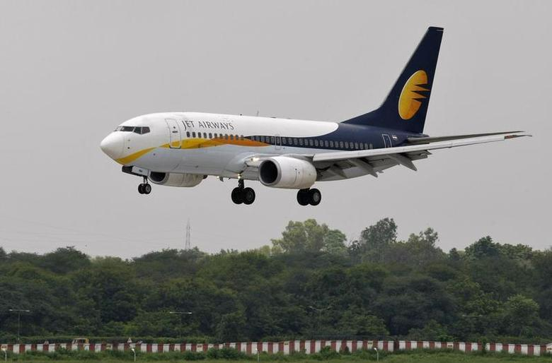 A Jet Airways passenger aircraft prepares to land at the airport in the western Indian city of Ahmedabad August 12, 2013. REUTERS/Amit Dave