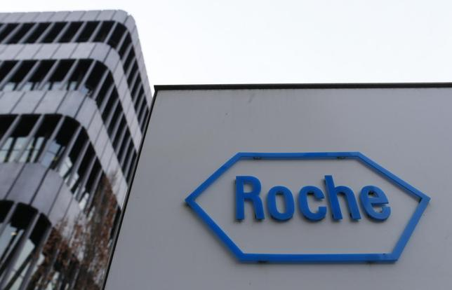 The logo of Swiss pharmaceutical company Roche is seen outside their headquarters in Basel January 30, 2014. REUTERS/Ruben Sprich