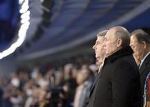 Russia's President Vladimir Putin (front) and International Olympic Committee (IOC) President Thomas Bach (L, back) attend the opening ceremony of the 2014 Sochi Winter Olympics, February 7, 2014. REUTERS/Alexei Nikolskyi/RIA Novosti/Kremlin