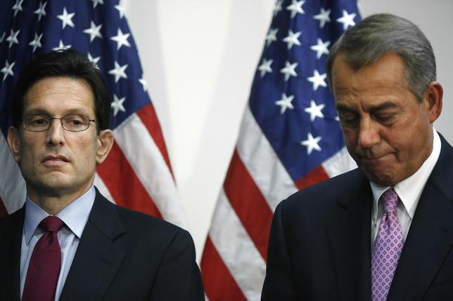 U.S. House Majority Leader Eric Cantor (R-VA) (L) stands with House Speaker John Boehner (R-OH) at a news conference after a House Republican caucus meeting at the U.S. Capitol in Washington, January 14, 2014. REUTERS/Jonathan Ernst