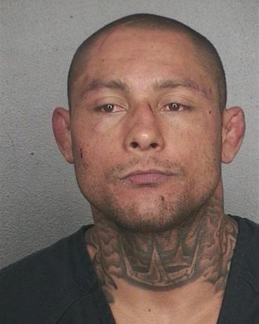 Thiago Silva, 31, who was arrested late Thursday night after threatening to shoot a packed South Florida martial arts gym, is shown in this Broward County Sheriff's Office photo released on February 7, 2014. REUTERS/Broward County Sheriff's Office/Handout via Reuters