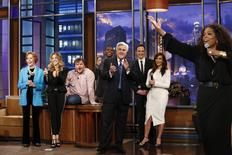 "Jay Leno listens to Oprah Winfrey sing on his final night hosting ""The Tonight Show with Jay Leno"" in Burbank, California in this February 6, 2014 picture provided by NBC. REUTERS/Stacie McChesney/NBC/Handout via Reuters"