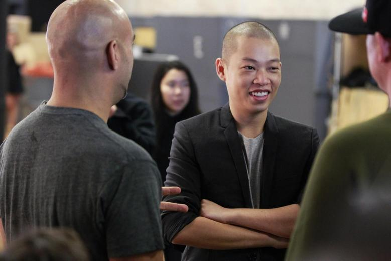 Designer Jason Wu laughs backstage while preparing to present his Spring/Summer 2014 collection during New York Fashion Week September 6, 2013. REUTERS/Lucas Jackson