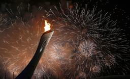 Fireworks explode after the Olympic Cauldron is lit during the opening ceremony of the Sochi 2014 Winter Olympics, February 7, 2014. REUTERS/Shamil Zhumatov