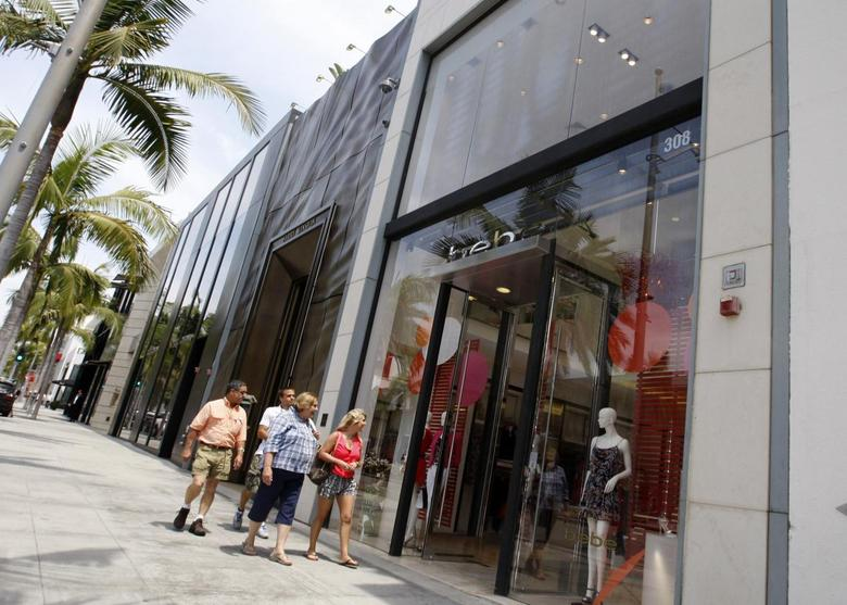 People walk past the Bebe store on Rodeo Drive in Beverly Hills, California, May 21, 2013. REUTERS/Fred Prouser